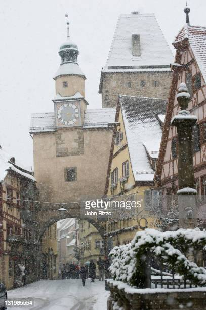 quaint, snow covered village - rothenburg stock photos and pictures