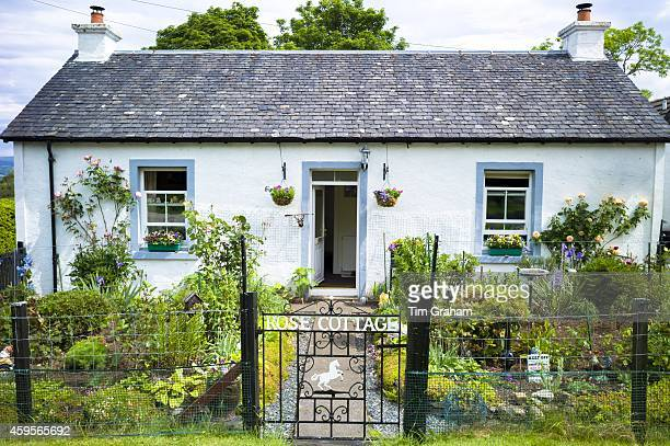 Quaint traditional bungalow cottage with neat front garden at Salen Isle of Mull in the Inner Hebrides and Western Isles West Coast of Scotland