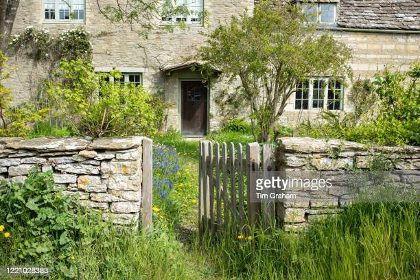 Quaint traditional country cottage in the rural village of Kelmscott in The Cotswolds, West Oxfordshire, UK.