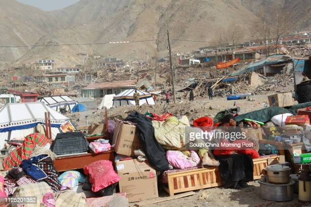 Quake survivor rests on the rubbles in Jiegu, Yushu country in northwest China's Qinghai province. The region was hit by the 7.1-magnitude earthquake...