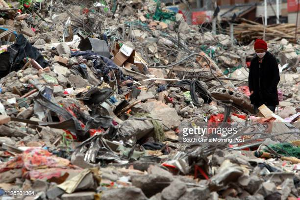 Quake victim in the town of Jiegu gazes at the debris left by the 7.1-magnitude quake that hit Yushu region last Wednesday, April 14, which has now...