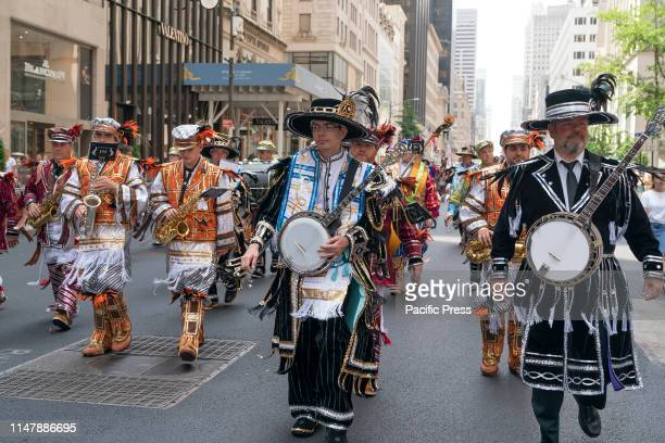 Quaker City String Band of Philadelphia performs on 55th Celebrate Israel Parade in New York on 5th Avenue .