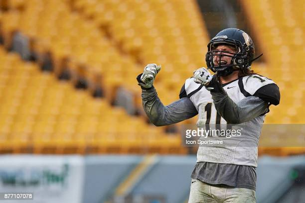 Quaker Valley junior Isaac Guss celebrates after making a play during the Western Pennsylvania Interscholastic Athletic League AAA Boys Football...
