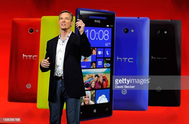 Qualcomm Inc Chairman and CEO Dr Paul E Jacobs displays a Windows 8x by HTC smartphone during a keynote address at the 2013 International CES at The...