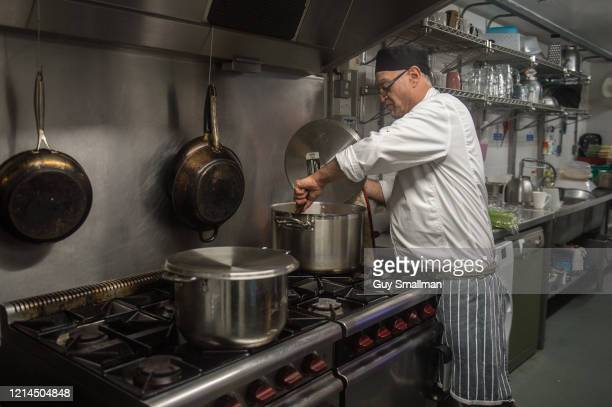 Qualified chef Simon Assaf prepares hot meals and food parcels at the Queen's Crescent Community Association on March 24, 2020 in Kentish Town, North...