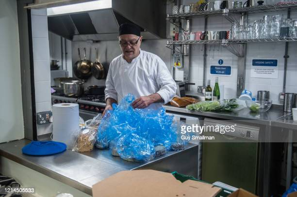 Qualified chef Simon Assaf prepares hot meals and food parcels at the Queen's Crescent Community Association on March 24 2020 in Kentish Town North...