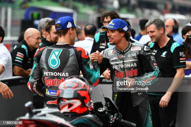 Qualifying first place Fabio Quartararo of France and third place Franco Morbidelli of Italy and Petronas Yamaha SRT shake hands after the qualifying...