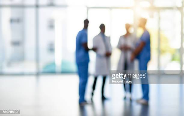 quality care from a quality team - group of doctors stock pictures, royalty-free photos & images