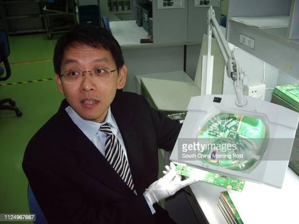 Quality check of a printed circuit board by Hannstar's chairman Chiao Yu-Heng in Jiangyin factory.