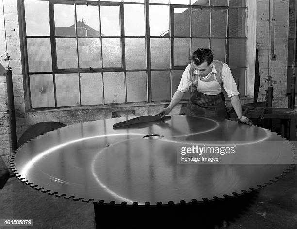 Quality checking a giant saw blade Edgar Allen's steel foundry Sheffield South Yorkshire 1963 This is a good example of the kind of specialist tools...