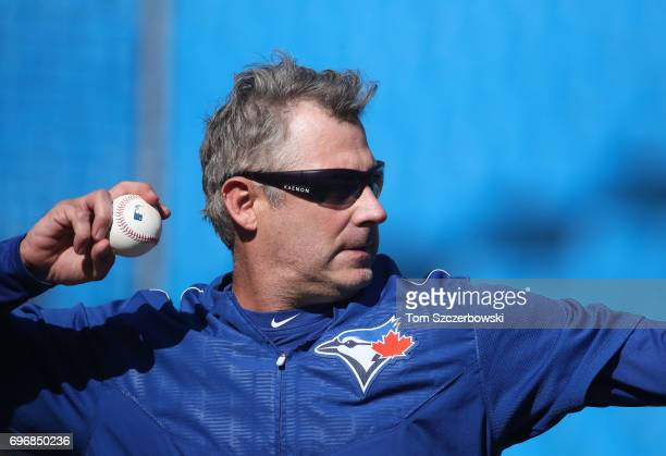 Quality control coach Derek Shelton of the Toronto Blue Jays pitches batting practice before the start of MLB game action against the Tampa Bay Rays...
