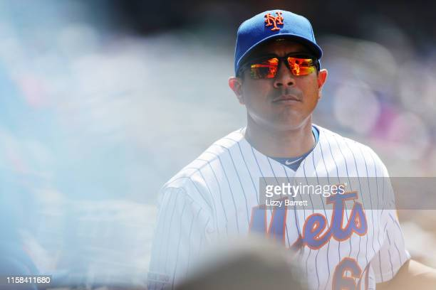 Quality control coach Luis Rojas looks on from the dugout during the game between the San Diego Padres and the New York Mets at Citi Field on...