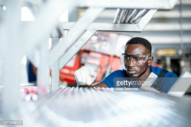 quality control engineer inspecting steel pipe material for production on shelf rack at factory warehouse. quality control assurance. - factory stock pictures, royalty-free photos & images