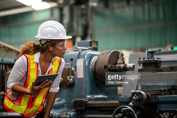 quality control engineer inspectiong or observing the lathe cnc machine in factory. prepare for the production process. - manufacturing stock pictures, royalty-free photos & images