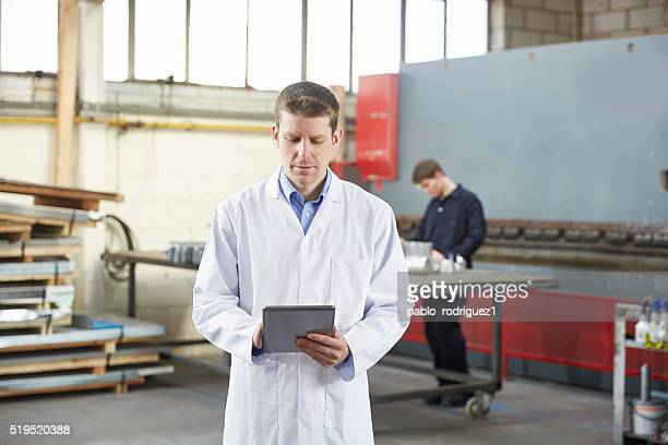 Quality control inspector in steel fabrication factory