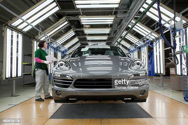 Quality control of a Porsche Cayenne at a Volkswagen plant on March 03 2011 in Bratislava Slovakia In this plant the VW Touareg and Audi Q7 models as...