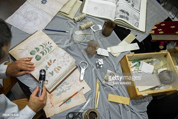 Quality control operator of the Spanish publishing outfit Siloe Luis Miguel works on cloning the illustrated codex hand-written manuscript Voynich in...