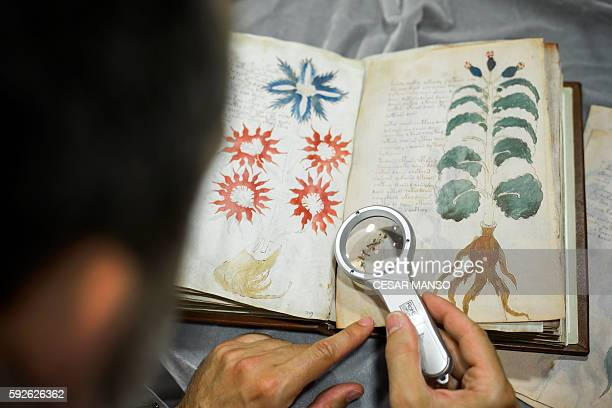 Quality control operator of the Spanish publishing outfit Siloe Luis Miguel works on cloning the illustrated codex handwritten manuscript Voynich in...