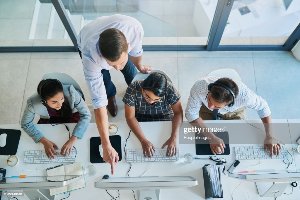 Quality customer service is a team effort : Stock Photo