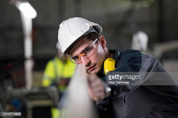 quality engineer working in automotive engineering industry while checking the quality of components, auto parts in production line. quality control and quality assurance concepts. - examining stock pictures, royalty-free photos & images