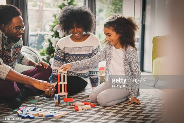 quality family time - board game stock pictures, royalty-free photos & images