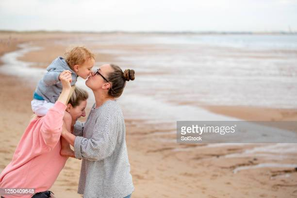 quality family time - parent stock pictures, royalty-free photos & images