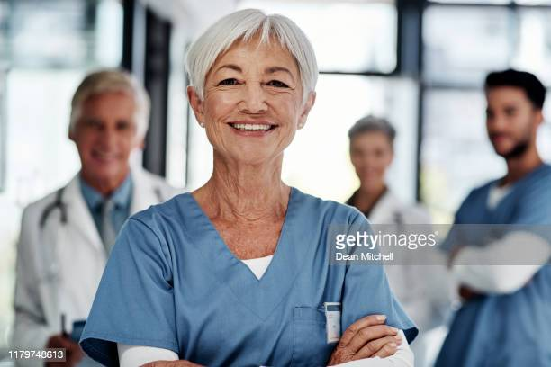 quality healthcare is exactly what we deliver - female nurse stock pictures, royalty-free photos & images