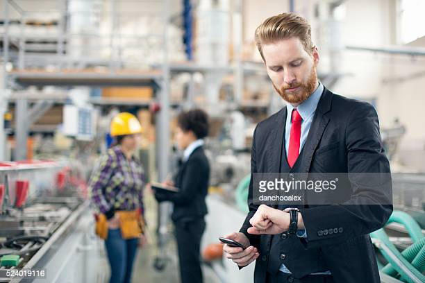 Quality inspector checking his watch