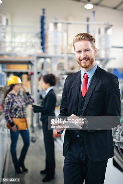 Quality inspector using tablet pc and smiling