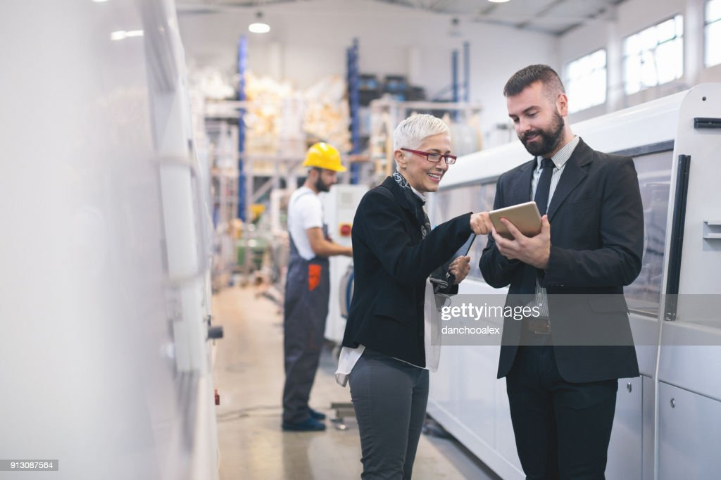Quality inspectors at the factory : Stock Photo