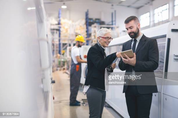 quality inspectors at the factory - automation stock pictures, royalty-free photos & images
