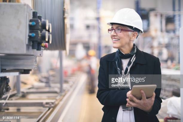 quality inspectors at the factory - inspector stock pictures, royalty-free photos & images