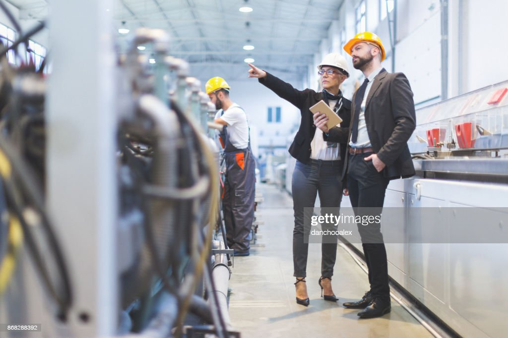Quality inspectors team at factory : Stock Photo