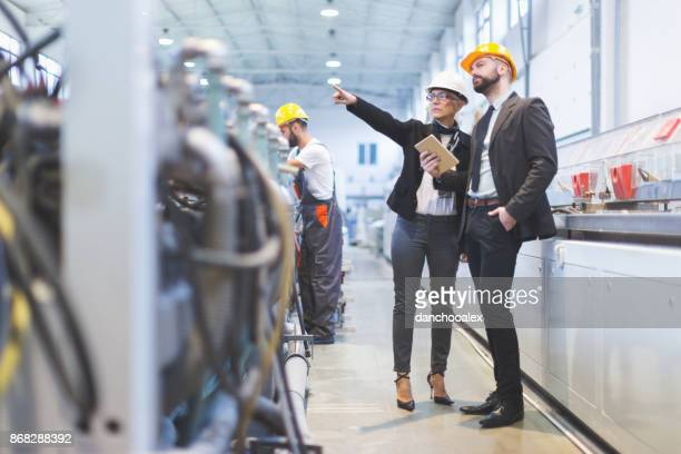 quality inspectors team at factory - inspector stock pictures, royalty-free photos & images