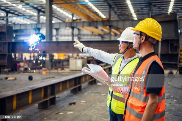 quality inspectors working in a steel factory - safety stock pictures, royalty-free photos & images