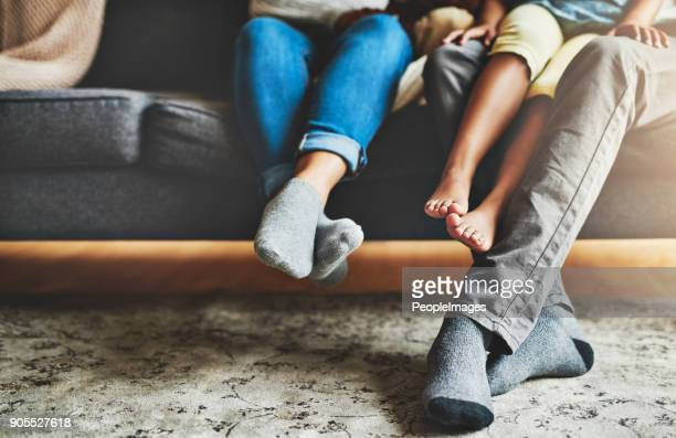 quality time from the comfort of the couch - piedi foto e immagini stock