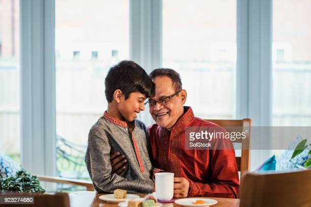 quality time with his grandson - eid mubarak stock pictures, royalty-free photos & images