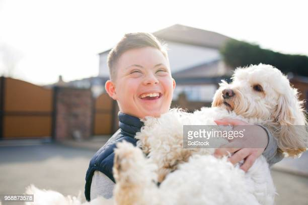 quality time with the dog - down syndrome stock pictures, royalty-free photos & images