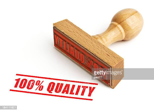 100% quality wooden stamp with red ink on white background