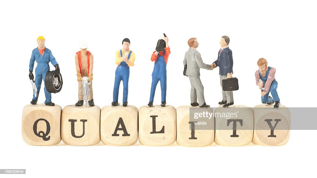 quality word with figurines : Stock Photo