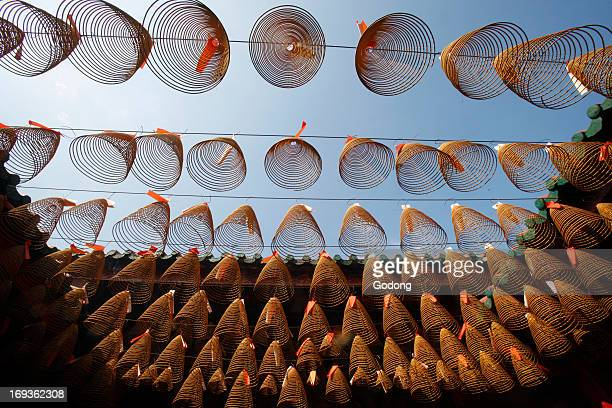 Quan Am Pagoda one of the oldest temples in the Chinese section of Ho Chi Minh City Incense coils hang from the ceiling