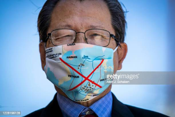 Quan Dinh, a volunteer at the Project Vietnam Foundation, wears a protective mask depicting Vietnam and the South China Sea at the Miyoco Medical...