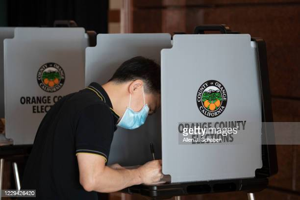 Quan Nguyen, of Santa Ana, votes early in the General Election at the Honda Center in Anaheim Monday, Nov. 2.