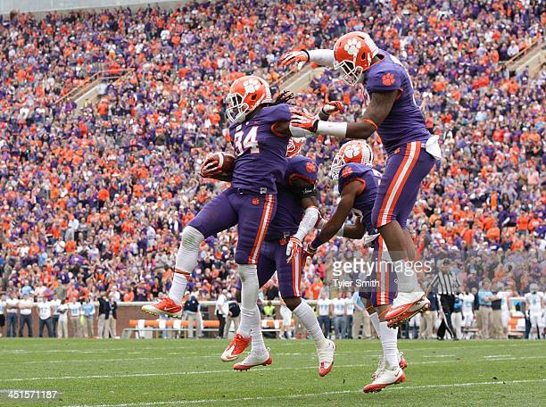 Quandon Christian of the Clemson Tigers celebrates with teammates after scoring a touchdown on a fumble recovery during the game against the Citadel...