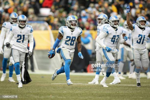 Quandre Diggs of the Detroit Lions celebrates after intercepting a pass in the fourth quarter against the Green Bay Packers at Lambeau Field on...