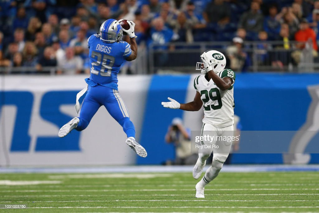 Quandre Diggs #28 of the Detroit Lions intercepts a pass intended for Bilal Powell #29 of the New York Jets in the first quarter at Ford Field on September 10, 2018 in Detroit, Michigan.