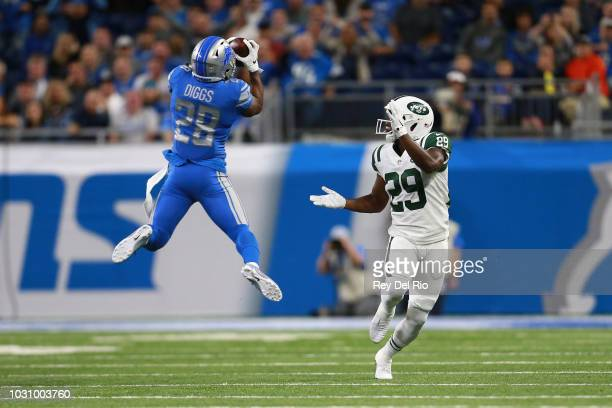 Quandre Diggs of the Detroit Lions intercepts a pass intended for Bilal Powell of the New York Jets in the first quarter at Ford Field on September...