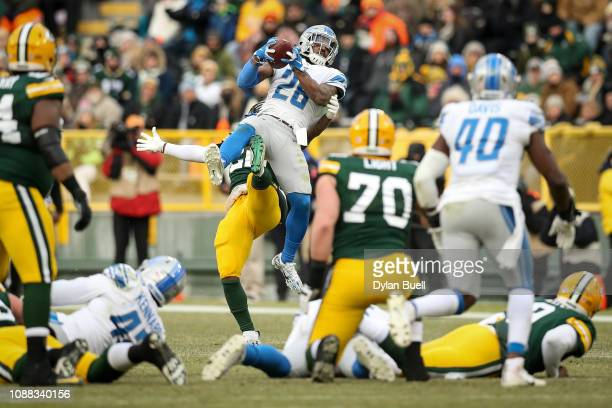 Quandre Diggs of the Detroit Lions intercepts a pass intended for Kapri Bibbs of the Green Bay Packers in the fourth quarter at Lambeau Field on...