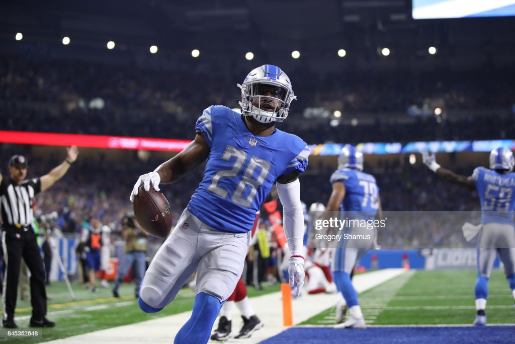 Quandre Diggs #28 of the Detroit Lions scores a touchdown during the second half against the Arizona Cardinals at Ford Field on September 10, 2017 in Detroit, Michigan.