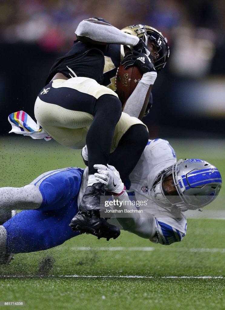 Quandre Diggs #28 of the Detroit Lions tackles Alvin Kamara #41 of the New Orleans Saints during the second half of a game at the Mercedes-Benz Superdome on October 15, 2017 in New Orleans, Louisiana.